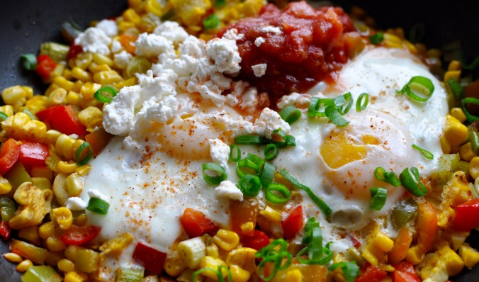 Skillet with vegetable hash, 2 eggs, salsa, and feta.