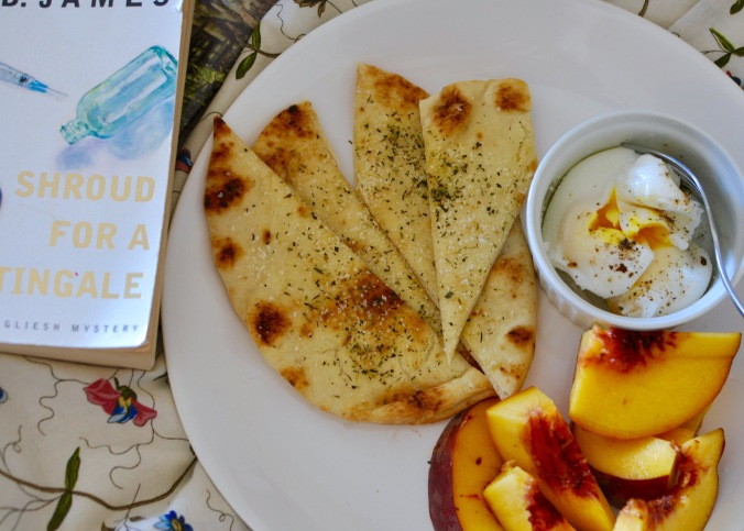 Breakfast in Bed with peaches, flatbread, and poached eggs.