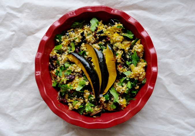 Pink platter with acorn squash and brown rice salad
