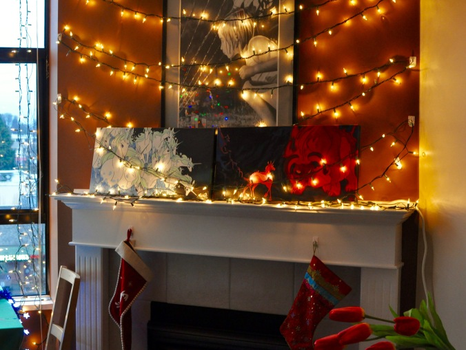 Christmas mantelpiece with lights crisscrossed across the wall.